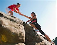 Rock climbers helping each other Stock Photo - Premium Royalty-Freenull, Code: 649-05649703