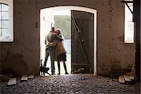 Couple hugging at barn doors Stock Photo - Premium Royalty-Freenull, Code: 649-05649813