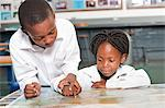 Boy and girl observing world map in classroom, Johannesburg, Gauteng Province, South Africa Stock Photo - Premium Royalty-Free, Artist: Mark Peter Drolet, Code: 682-05649916