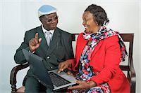 Kenyan grandparents playing together on a laptop, Nairobi, Kenya Stock Photo - Premium Royalty-Freenull, Code: 682-05650114