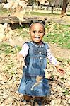 Toddler girl throwing autumn leaves up in air and smiling broadly, Johannesburg, South Africa Stock Photo - Premium Royalty-Freenull, Code: 682-05650593