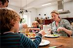 Family sitting down and eating a healthy meal together Stock Photo - Premium Royalty-Freenull, Code: 614-05650641