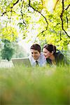Business people using laptop on ground in park Stock Photo - Premium Royalty-Freenull, Code: 635-05651404