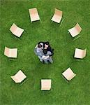Business people hugging outdoors Stock Photo - Premium Royalty-Free, Artist: Ikon Images, Code: 635-05651425