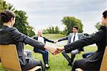 Business people holding hands in a circle outdoors Stock Photo - Premium Royalty-Free, Artist: Rick Gomez, Code: 635-05651426