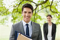 Business people standing together outdoors Stock Photo - Premium Royalty-Freenull, Code: 635-05651440