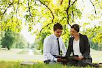 Business people looking at report outdoors Stock Photo - Premium Royalty-Free, Artist: Ikon Images, Code: 635-05651444