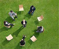 Business people having meeting outdoors Stock Photo - Premium Royalty-Freenull, Code: 635-05651449
