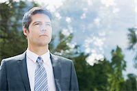 Businessman looking through window Stock Photo - Premium Royalty-Freenull, Code: 635-05651455