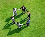 Business people holding hands in circle outdoors Stock Photo - Premium Royalty-Free, Artist: Kevin Dodge, Code: 635-05651467