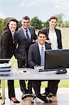 Business people working together at desk outdoors Stock Photo - Premium Royalty-Free, Artist: Ascent Xmedia, Code: 635-05651476