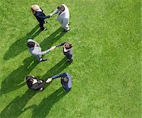 Business people shaking hands together outdoors Stock Photo - Premium Royalty-Freenull, Code: 635-05651478