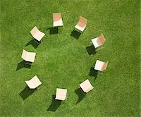 Chairs in circle formation on grass Stock Photo - Premium Royalty-Freenull, Code: 635-05651503