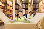 Woman in warehouse closing cardboard box Stock Photo - Premium Royalty-Freenull, Code: 635-05651507