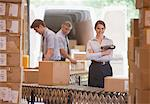 Woman holding scanner in shipping warehouse Stock Photo - Premium Royalty-Freenull, Code: 635-05651520