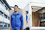 Deliverymen carrying large box from van Stock Photo - Premium Royalty-Freenull, Code: 635-05651545