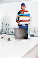 piles of work - Deliveryman carrying boxes in office Stock Photo - Premium Royalty-Freenull, Code: 635-05651555
