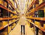 Worker carrying boxes in warehouse Stock Photo - Premium Royalty-Free, Artist: Aflo Relax, Code: 635-05651559