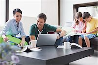 Family relaxing together in living room Stock Photo - Premium Royalty-Freenull, Code: 635-05651562