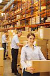 Workers packing boxes in warehouse Stock Photo - Premium Royalty-Freenull, Code: 635-05651571