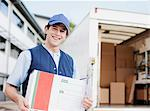 Deliveryman holding package Stock Photo - Premium Royalty-Freenull, Code: 635-05651573