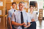 Business people standing together in warehouse Stock Photo - Premium Royalty-Free, Artist: Blend Images, Code: 635-05651575