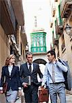 Business people walking together in city Stock Photo - Premium Royalty-Free, Artist: Blend Images, Code: 635-05651599