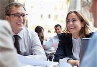 Business people working in sidewalk cafe Stock Photo - Premium Royalty-Freenull, Code: 635-05651631