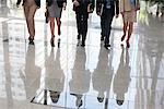 Business people walking together Stock Photo - Premium Royalty-Freenull, Code: 635-05651637