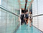 Business people walking together Stock Photo - Premium Royalty-Freenull, Code: 635-05651642