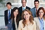 Business people standing together Stock Photo - Premium Royalty-Freenull, Code: 635-05651649