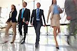 Business people walking together Stock Photo - Premium Royalty-Freenull, Code: 635-05651655