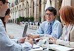 Business people working together in sidewalk cafe Stock Photo - Premium Royalty-Freenull, Code: 635-05651662