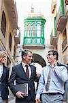 Business people walking together on city street Stock Photo - Premium Royalty-Freenull, Code: 635-05651671