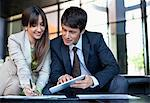 Business people using digital tablet together Stock Photo - Premium Royalty-Freenull, Code: 635-05651675
