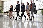 Business people walking together in lobby Stock Photo - Premium Royalty-Free, Artist: Blend Images, Code: 635-05651697