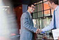Businessmen shaking hands Stock Photo - Premium Royalty-Freenull, Code: 635-05651703