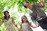 Family holding hands together outdoors Stock Photo - Premium Royalty-Freenull, Code: 635-05651729