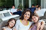 Family relaxing on patio together Stock Photo - Premium Royalty-Free, Artist: Blend Images, Code: 635-05651732