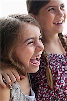 preteen open mouth - Grinning girls standing together Stock Photo - Premium Royalty-Freenull, Code: 635-05651771