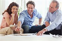 Couple talking with their financial advisor Stock Photo - Premium Royalty-Freenull, Code: 635-05651823