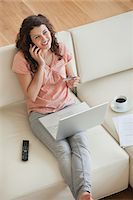 Woman shopping online with credit card Stock Photo - Premium Royalty-Freenull, Code: 635-05651834