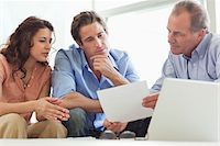 Couple going over paperwork with financial advisor Stock Photo - Premium Royalty-Freenull, Code: 635-05651864
