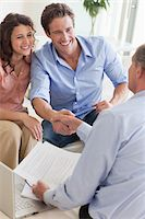 Couple shaking hands with financial advisor Stock Photo - Premium Royalty-Freenull, Code: 635-05651887