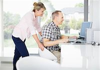 partnership - Couple using computer together Stock Photo - Premium Royalty-Freenull, Code: 635-05651899