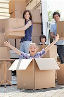 side view tractor trailer truck - Girl playing in moving box Stock Photo - Premium Royalty-Freenull, Code: 635-05652106