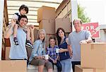 Family taking break near moving van Stock Photo - Premium Royalty-Free, Artist: Blend Images, Code: 635-05652115