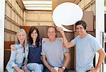 Friends at back of moving van, one holding a comment bubble Stock Photo - Premium Royalty-Freenull, Code: 635-05652116