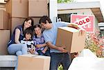Family unloading boxes from moving van Stock Photo - Premium Royalty-Free, Artist: Blend Images, Code: 635-05652123