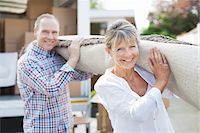Couple carrying rug together Stock Photo - Premium Royalty-Freenull, Code: 635-05652126
